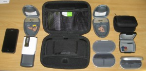Full range of hearing aid cases - iPhone 4S on left for scale